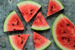 Sliced watermelon. Fresh watermelon pieces on a metal board Royalty Free Stock Photo