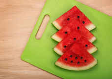 Sliced watermelon  on green plastic wood board Stock Images