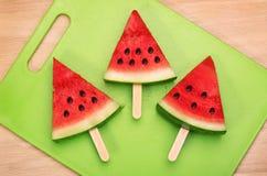 Sliced watermelon  on green plastic wood cutting board Stock Photos