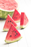 Sliced watermelon on kitchen table Royalty Free Stock Photos