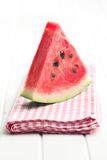 Sliced watermelon on kitchen table Royalty Free Stock Photography