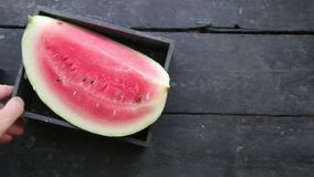 The sliced watermelon on kitchen table stock video footage