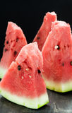 Sliced watermelon over dark background Royalty Free Stock Image
