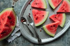 Sliced watermelon. Pieces of watermelon laying on a metal tray Royalty Free Stock Photography