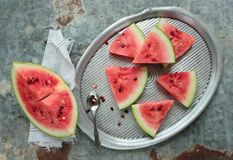 Sliced watermelon. Watermelon sliced in pieces on a metal tray Stock Photography