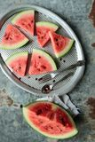 Sliced watermelon. Watermelon pieces sliced in triangle on a tray Stock Images