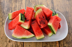 Sliced watermelon on plate with wood table Royalty Free Stock Photos