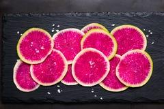Sliced watermelon radish with sea salt Stock Photo