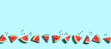 Sliced watermelons arranged. On a blue background royalty free illustration