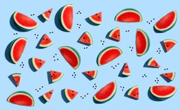 Sliced watermelons arranged. On a blue background stock illustration