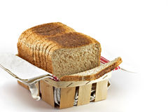 Sliced wheat bread. A loaf of sliced wheat bread in a basket Royalty Free Stock Photography