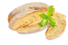 Sliced wheat bread and basil on white. stock image