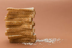 Wheat toast. Sliced wheat bread  on brown background Stock Photos