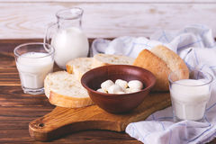 Sliced wheat bread, glass of fresh milk and mozzarella Royalty Free Stock Photos
