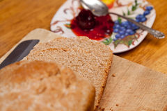 Sliced wheat bread and jam Stock Images