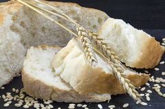 Sliced wheat white bread with wheat grains Stock Image
