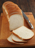 Sliced white bread. On a cooking wooden board Royalty Free Stock Photography