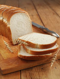 Sliced white bread. On a wooden board Royalty Free Stock Photography