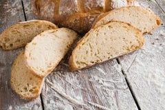 Bakery concept. Plenty of sliced white bread background. Sliced white bread, bakery background on rustic wood, closeup, copy space stock photos