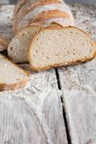 Bakery concept. Plenty of sliced white bread background. Sliced white bread, bakery background on rustic wood, vertical, closeup, copy space stock image