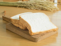 Sliced white bread. On the chopping board Stock Photo