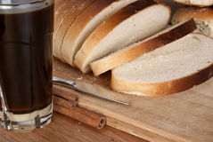 Sliced White Bread Loaf & Coffee in a Thumbler Royalty Free Stock Photography