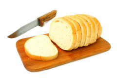 Sliced white bread on a wood cutting board Royalty Free Stock Images