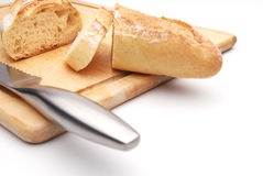 Sliced white bread on a wood cutting board. White background Royalty Free Stock Image