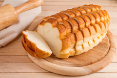 Sliced white bread on wood plate. Royalty Free Stock Photography