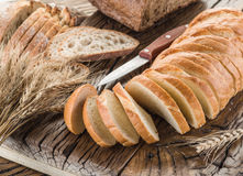 Sliced white bread on the wooden plank. Stock Photography