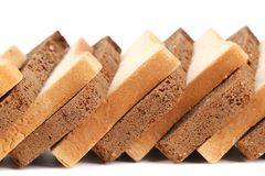 Sliced white and brown loaf of bread. Stock Photos