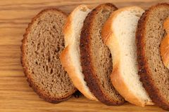 Sliced white and brown  loaf of bread Royalty Free Stock Photography