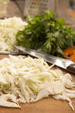 Sliced white cabbage for preparing salad or sauerkraut royalty free stock photography