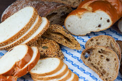 Sliced white and wholegrain bread on a tablecloth Royalty Free Stock Photography