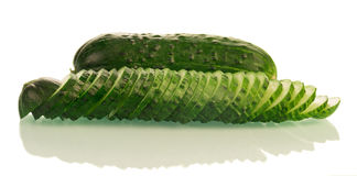 Sliced and whole cucumbers Stock Photo
