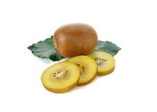 Sliced and whole golden kiwi fruit on white Stock Photo
