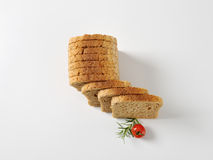 Sliced whole grain bread. Sliced loaf of whole grain bread royalty free stock images