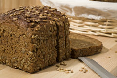 Sliced whole grain brown bread Royalty Free Stock Images