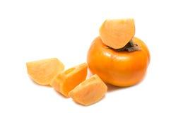 Sliced and whole khaki fruits Royalty Free Stock Images