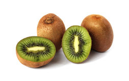 Sliced and whole kiwi. On a white background Stock Images