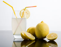Sliced and whole lemons Royalty Free Stock Images