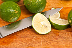 Sliced and whole limes Royalty Free Stock Photography