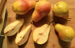 Sliced and whole pears on cutting board overhead view Stock Photo