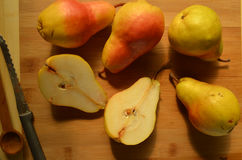 Sliced and whole pears on cutting board overhead view Royalty Free Stock Images