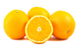 Sliced and whole ripe orange fruits Stock Photo