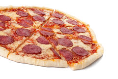 Sliced whole salami pizza Royalty Free Stock Photo