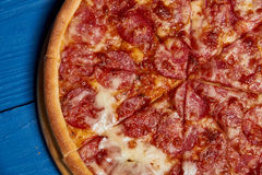 Sliced whole salami pizza. Stock Photography