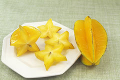 Sliced and Whole Star Fruits Royalty Free Stock Image
