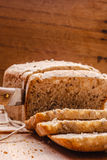 Sliced whole wheat bread on cutting board Stock Image