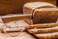 Sliced whole wheat bread on cutting board Stock Photo